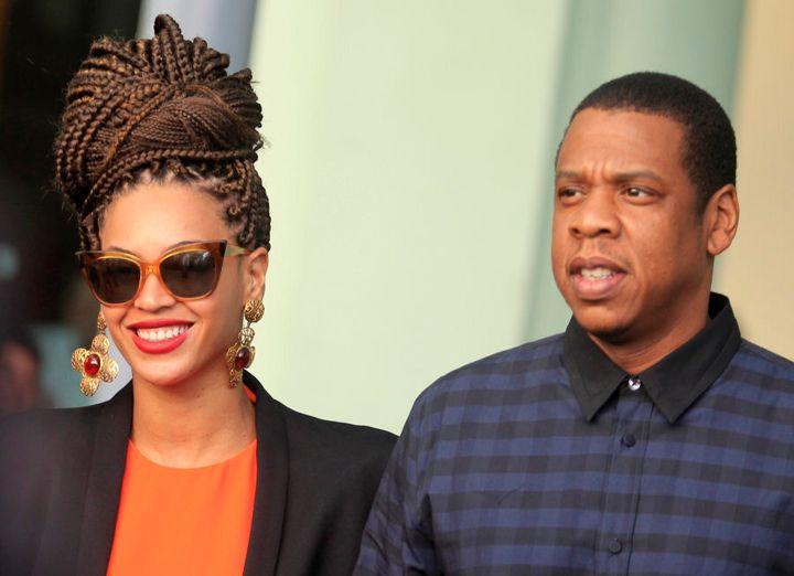 U.S. singer Beyonce (L) and her husband rapper Jay-Z walk as they leave their hotel in Havana April 4, 2013. REUTERS/Enrique De La Osa (CUBA - Tags: ENTERTAINMENT)