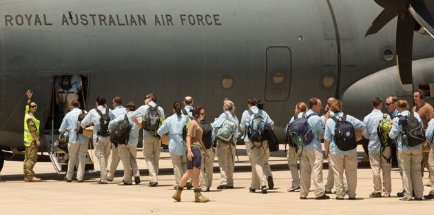 Australian teams board a plane at the RAAF Base enroute to to the