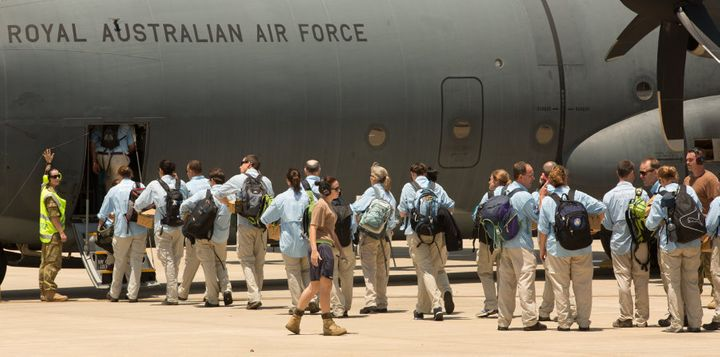 Australian teams board a plane at the RAAF Base enroute to to the Philippines.