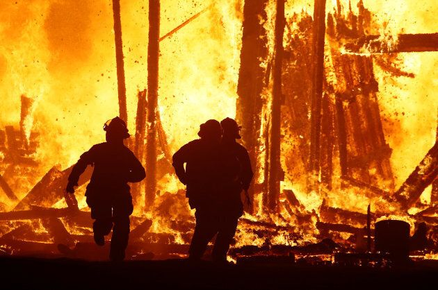 Firefighters are forced to abandon their attempted rescue of a Burning Man participant who ran into the...