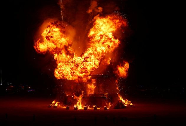 The Man is engulfed in flames at Burning Man