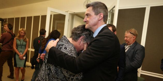 Rodney Croome comforts Shelley Argent after Opposition Leader Bill Shorten's press conference at Parliament