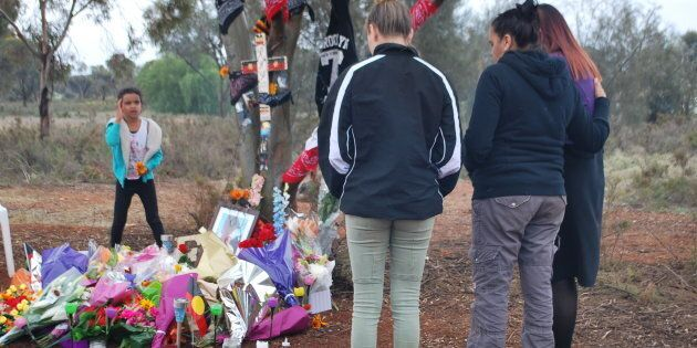 Mourners pay their respects at a tribute to dead teen Elijah Doughty in