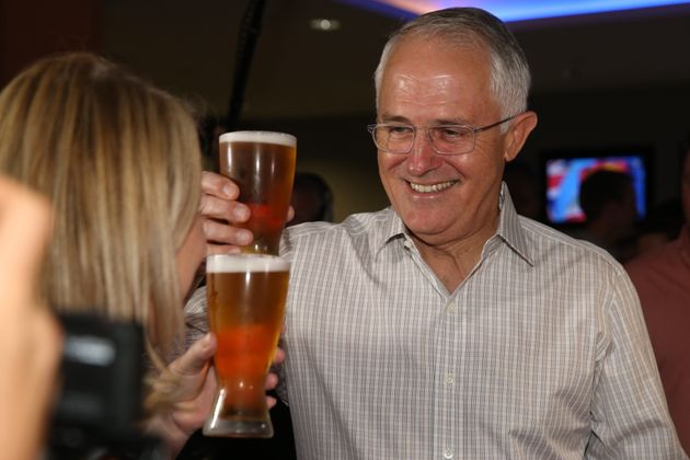 Malcolm Turnbull enjoys a beer at a local pub in Darwin during the
