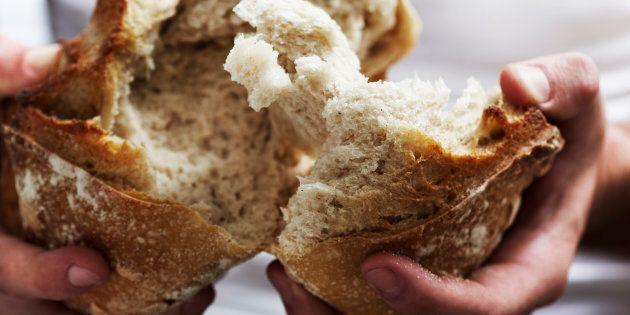 Man breaking bread.