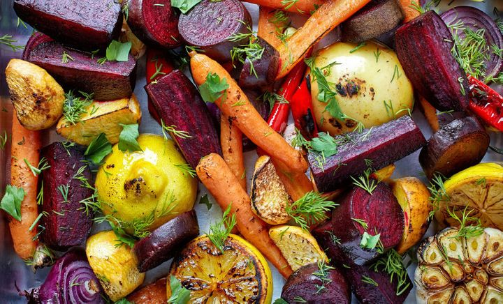 Bored of plain veggies? Try roasting them with fresh herbs and olive oil.