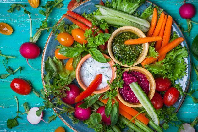 Dip veggie sticks into homemade hummus, tzatziki and