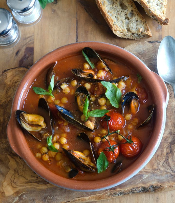 Spicy harissa mussels with tomato, chickpeas and basil.