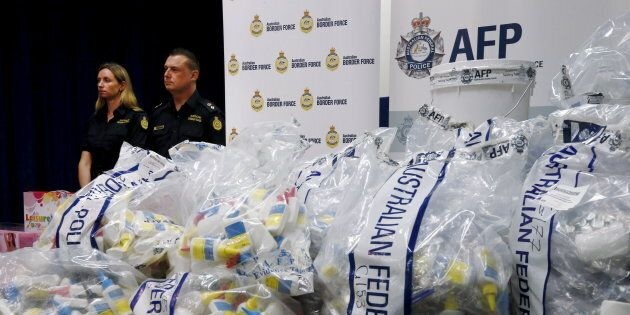 A quantity of liquid methamphetamine disguised in various packaging is put on display by Australian Border...