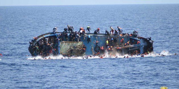 Anovercrowded migrant boatshortly before capsizing in the Mediterranean Sea between Libya and Italy on Wednesday. The Italian navy rescued over 500 passengers but several drowned.