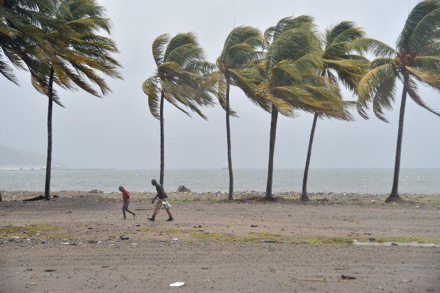 Haitian people walk through the wind and rain on a beach, in Cap-Haitien as Hurricane Irma approaches.