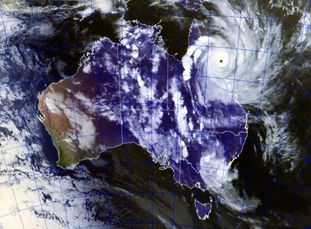 While some of the swirling arms of cloud extend over a vast area, the cyclonic-strength part of Yasi...
