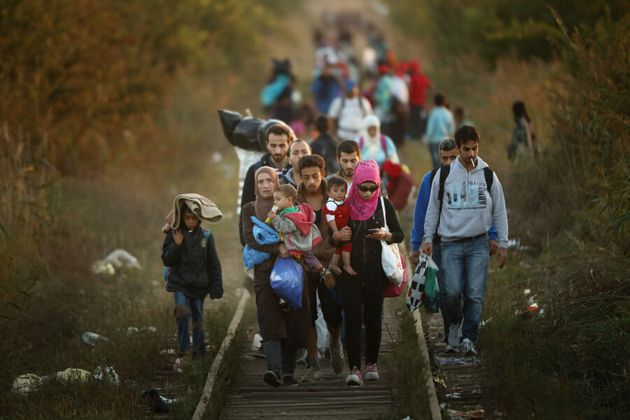 Syrian refugees trek across train tracks, looking for safety (Getty Images/Christopher