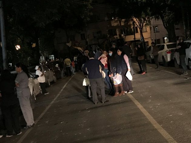 People gather on a street after an earthquake hit Mexico City, Mexico late September 7,