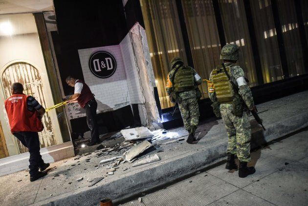 Members of the Mexican army look at damage caused by an earthquake in the Port of Veracuz on September...