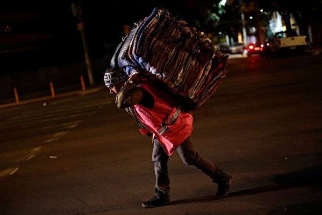 A volunteer carries blankets after an earthquake hit Mexico City, Mexico, September 8,