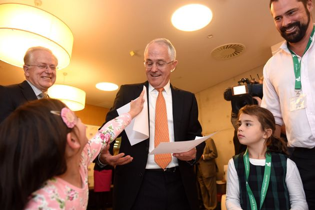 Prime Minister Malcolm Turnbull makes a new friend on day 23 of the campaign