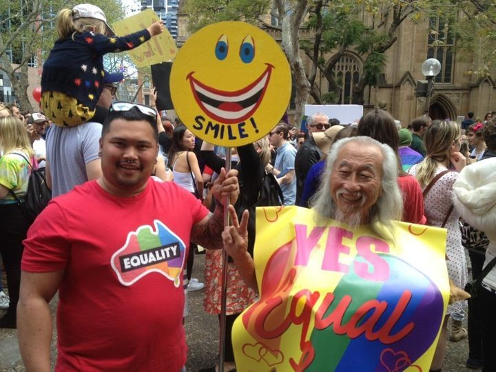 Gay marriage supporter Warren (left) with Sydney peace activist Danny Lim.