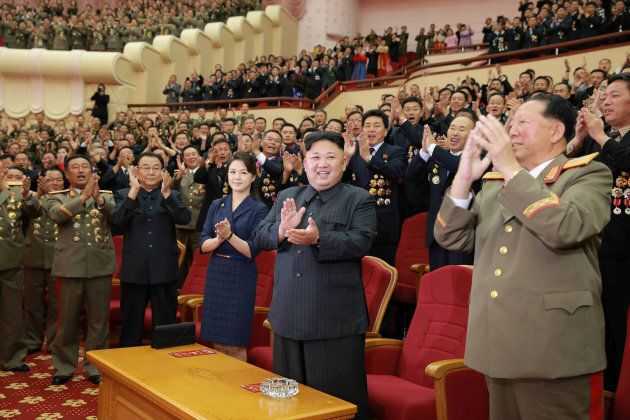 North Korean leader Kim Jong Un claps during a celebration for nuclear scientists and engineers who contributed...