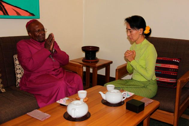 Nobel peace prize laureates, Myanmar's pro-democracy leader Aung San Suu Kyi (R) and South African social...