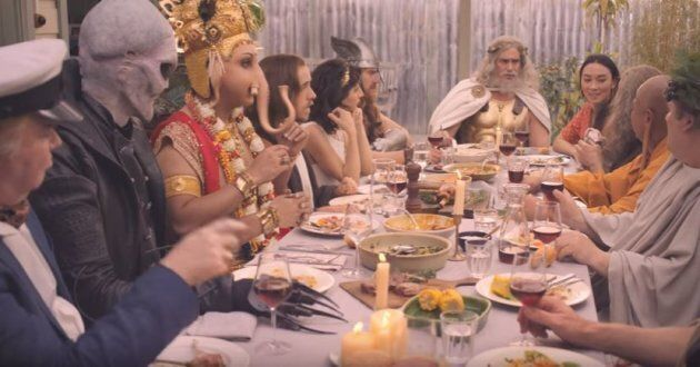 The various deities, gathered around the table in the MLA ad.