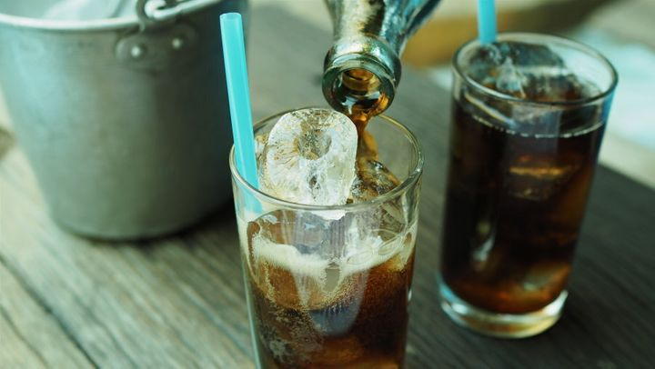 While water is best, the occasional soft drink (diet or otherwise) won't kill you.