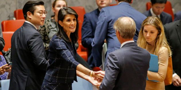United States Ambassador to the United Nations Nikki Haley speaks with Sweden's ambassador Olof Skoog...