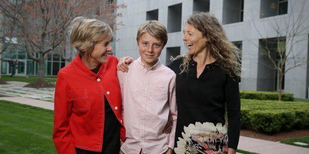 Eddie Blewett with his mums Neroli Dickson and Claire Blewett, in September