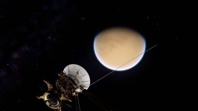 The Cassini spacecraft approaches Saturn's largest moon Titan.