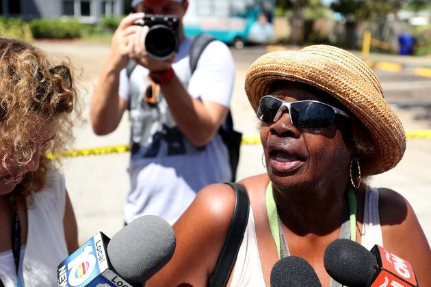 Flora Mitchell, of Dania Beach, answers questions from the media outside of the nursing