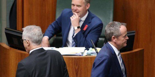 Opposition Leader Bill Shorten passes Prime Minister Malcolm Turnbull to vote against the Plebiscite...