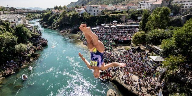 Wheeeee! This is Iffland diving off the famous Mostar Bridge in Bosnia and