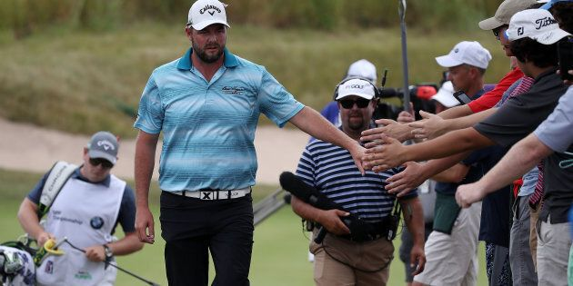 Marc Leishman greets fans during the final round of the BMW Championship at Conway Farms Golf Club in...