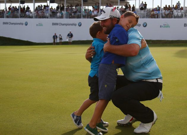 Marc Leishman celebrates with sons Oliver and Harry after winning the BMW