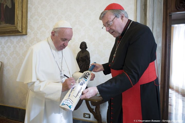 Pope Francis, pictured here signing a cricket bat received from George Pell at the Vatican, is not expected to accept the Cardinal's resignation.