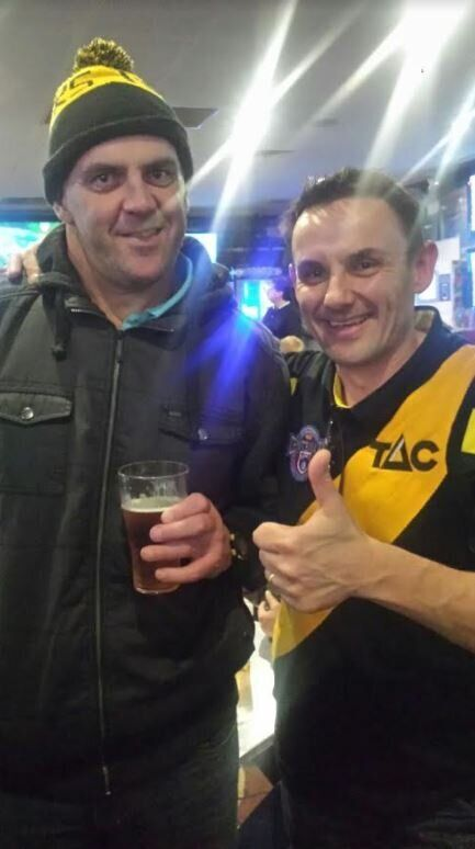 That's Steve on the right with his favourite Richmond player Scott Turner (in the beanie), whom he just...