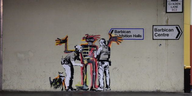 One of two new murals painted by the artist Banksy near the Barbican Centre in London. The works mark the opening of an exhibition by American artist Jean-Michel Basquiat at the arts venue.
