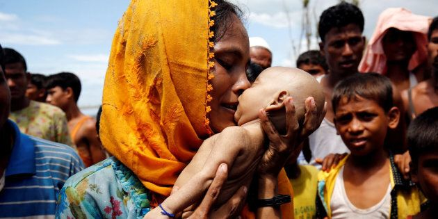 ATTENTION EDITORS - VISUAL COVERAGE OF SCENES OF INJURY OR DEATH Hamida, a Rohingya refugee woman mourns as she holds her 40-day-old son, who died after a boat capsized in the shore of Shah Porir Dwip, in Teknaf, Bangladesh September 14, 2017. REUTERS/Mohammad Ponir Hossain  TEMPLATE OUT     TPX IMAGES OF THE DAY