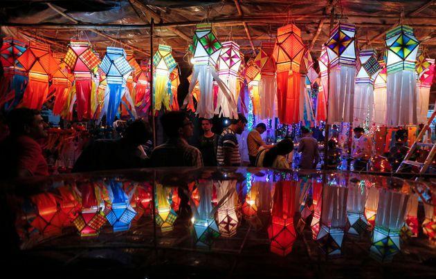 Customers shop for lanterns at a roadside Diwali market in