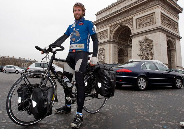 Beaumont pictured next to the Arc de Triomphe after completing his tour.