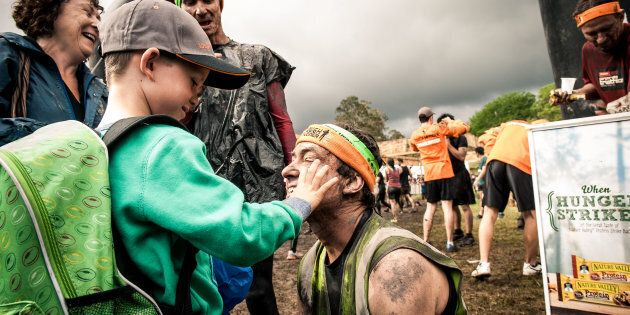 Robin Braidwood and his seven-year-old son Kyte after finishing Tough Mudder. Robin is completely