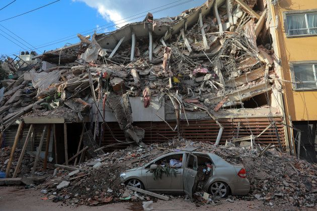 Wreckage of a building knocked down by a magnitude 7.1 earthquake that jolted central Mexico damaging...
