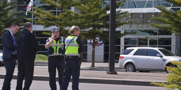 Police were shepherding people away from AFL House in Melbourne on Thursday