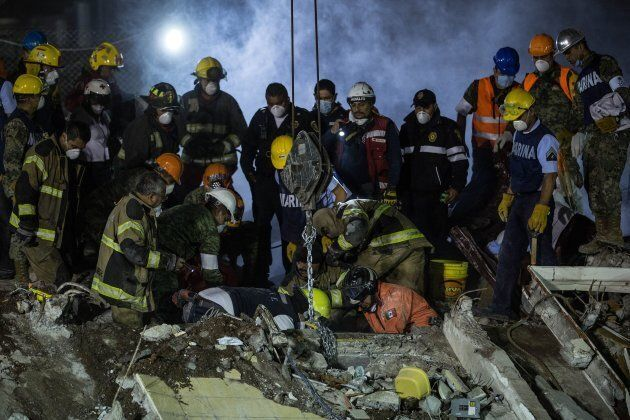 Rescue workers search for trapped citizens after a powerful magnitude 7.1