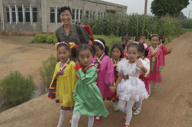 Children prepare for a performance in Onchon County near Pyongyang, North