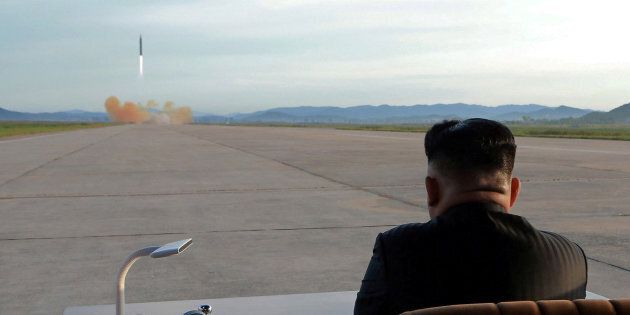 North Korean leader Kim Jong Un watches the launch of a Hwasong-12