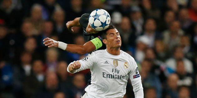Paris St Germain's Thiago Silva in action with Real Madrid's Cristiano Ronaldo.