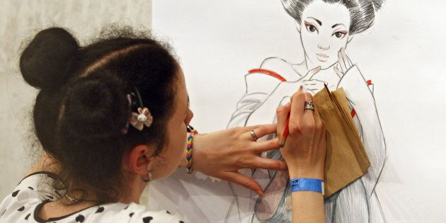 A girl draws during the 'Kyiv Comic Con'