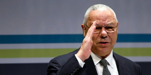 Former U.S. Secretary of State Colin Powell salutes the audience as he takes the stage at the Washington...