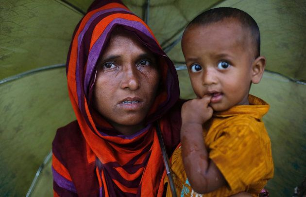 A Rohingya refugee woman cries as she waits for aid at a camp in Cox's Bazar,
